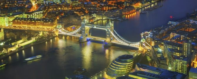 Aerial overview of London city with the Tower bridge at the night time