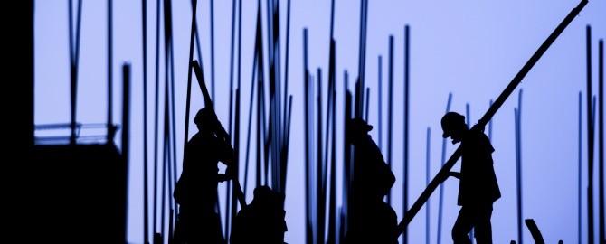Men with poles 000042437976 670x270